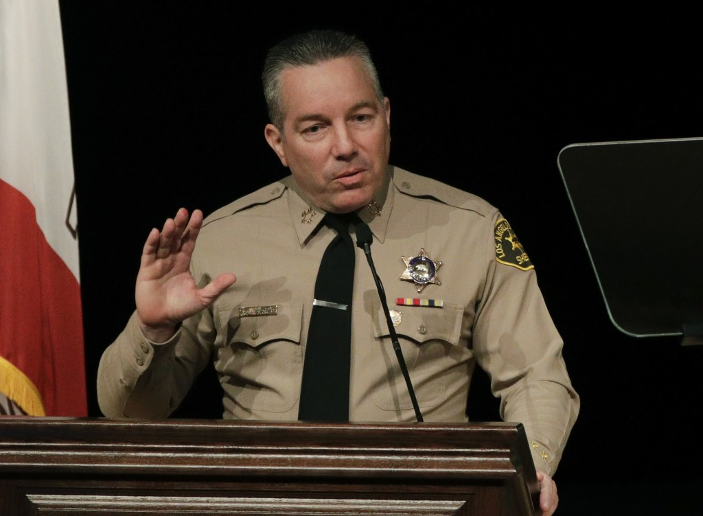 FILE - In this Dec. 3, 2018 file photo newly-elected Los Angeles County Sheriff Alex Villanueva speaks during a swearing-in ceremony in Monterey Park,...