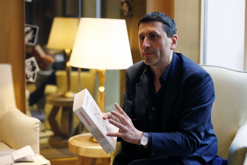 "French writer Frederic Martel gestures during an interview with Associated Press, in Paris, Friday, Feb. 15, 2019. In the explosive book ""In the Close..."