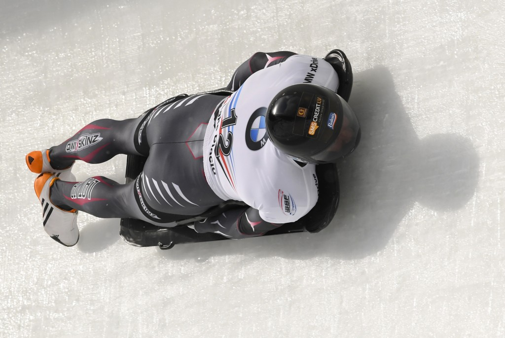 Martins Dukurs, of Latvia, rounds a curve during the first run of the men's Skeleton World Cup Saturday Feb. 16, 2019, in Lake Placid, N.Y. (AP Photo/...