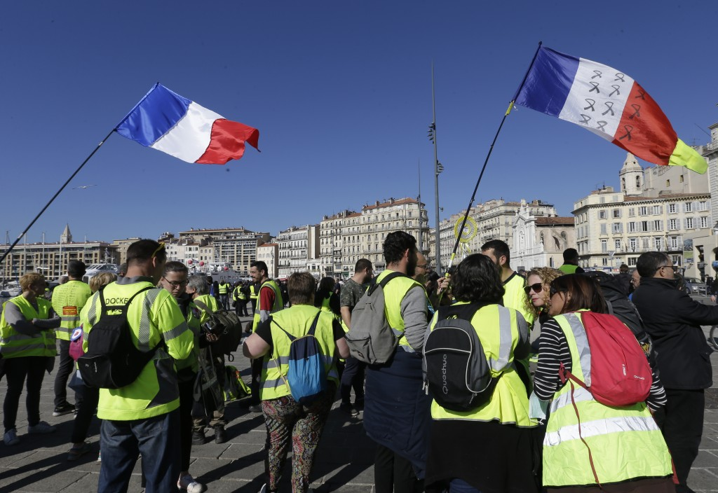 Yellow vest protesters gather for a demonstration Saturday, Feb.16, 2019 in Marseille, southern France. Yellow vest protesters are holding scattered d...