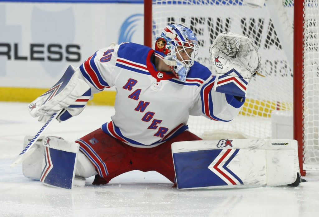 New York Rangers goalie Alexandar Georgiev (40) makes a save during the first period of an NHL hockey game against the Buffalo Sabres, Friday, Feb. 15...