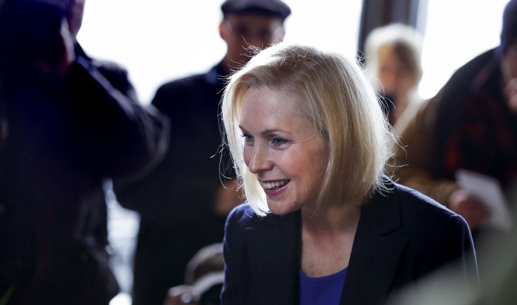 Sen. Kirsten Gillibrand, D-NY, smiles as she listens to a patron while visiting a coffee shop on Main Street in Concord, N.H., Friday, Feb. 15, 2019. ...