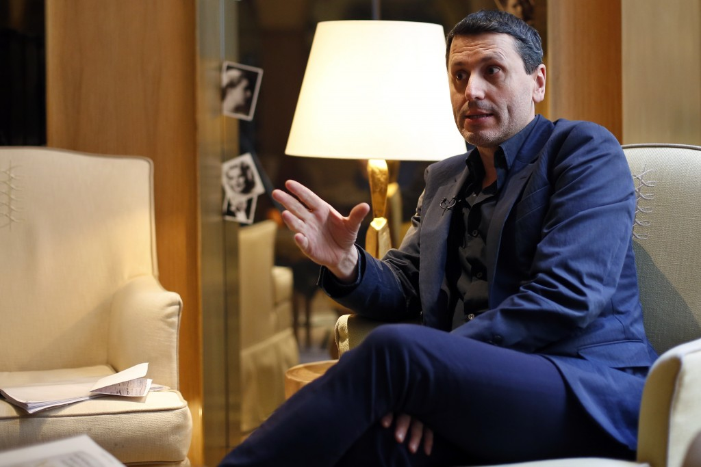 """French writer Frederic Martel gestures during an interview with Associated Press, in Paris, Friday, Feb. 15, 2019. In the explosive book """"In the Close"""