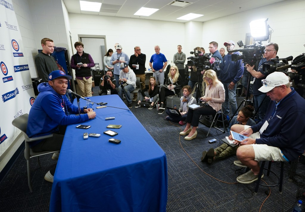 Chicago Cubs shortstop Addison Russell speaks at a press conference after a spring training baseball workout Friday, Feb. 15, 2019, in Mesa, Ariz. (AP...