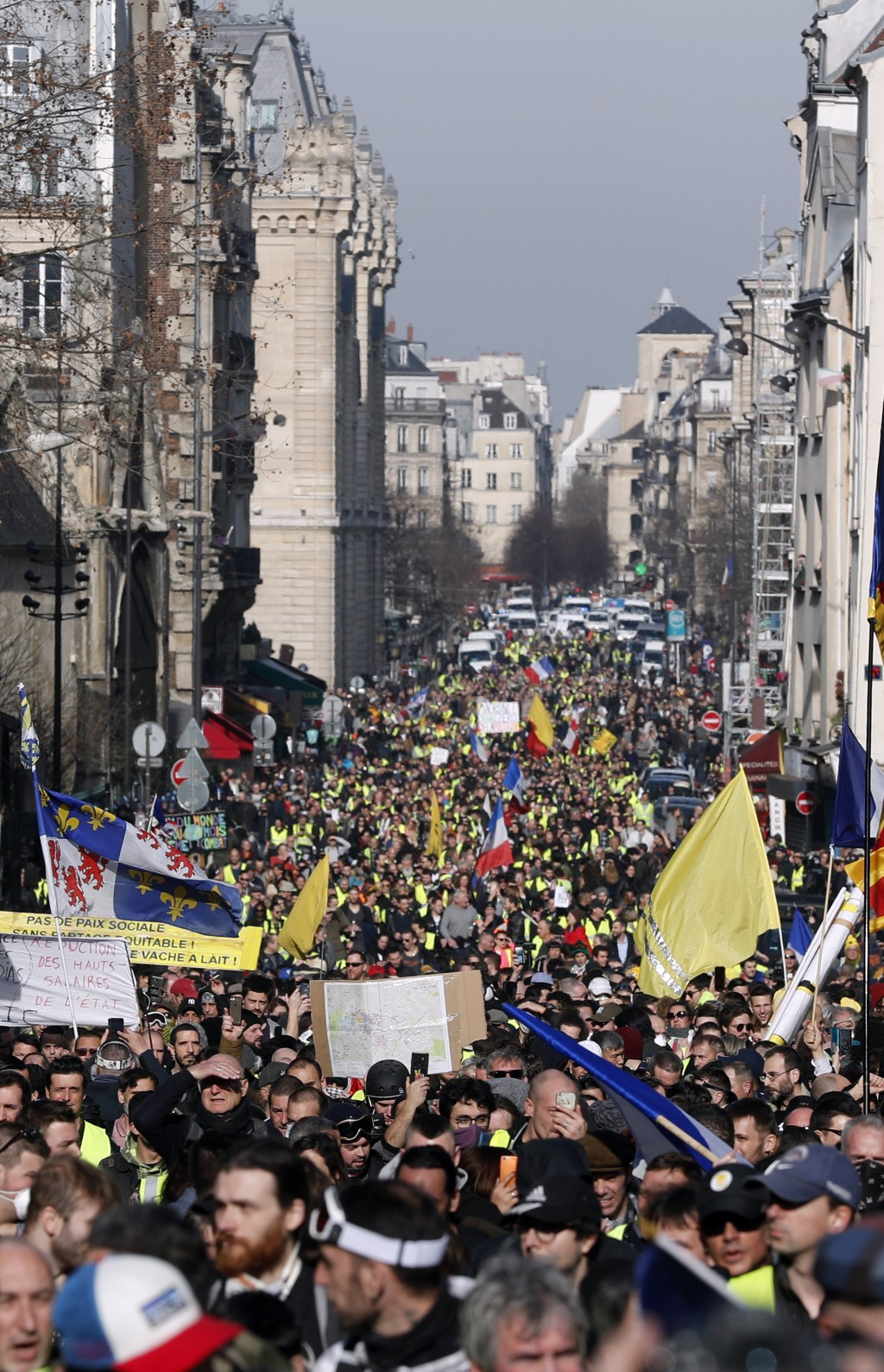 Yellow vest protesters march Saturday, Feb.16, 2019 in Paris. Yellow vest protesters are holding scattered demonstrations around Paris and the rest of...
