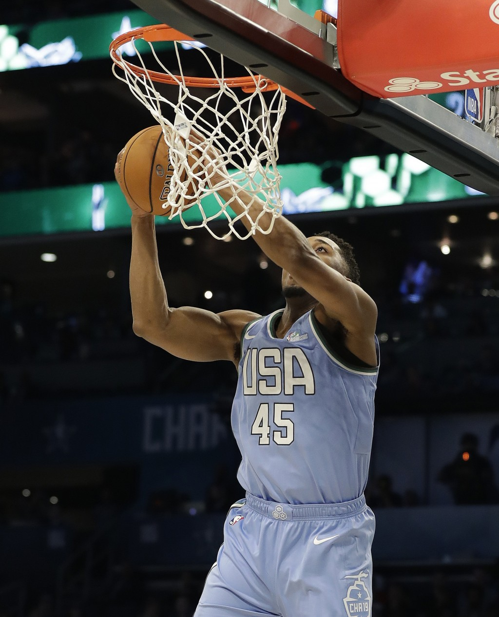 U.S. Team's Donovan Mitchell, of the Utah Jazz, heads to the basket against the World Team during the NBA All-Star Rising Stars basketball game, Frida...