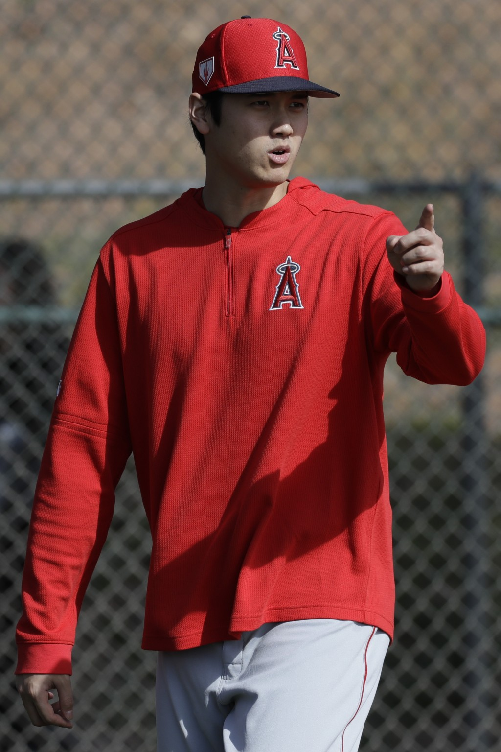 Los Angeles Angels' Shohei Ohtani, of Japan, walks on the practice field during spring training baseball in Tempe, Ariz., Friday, Feb. 15, 2019. (AP P...