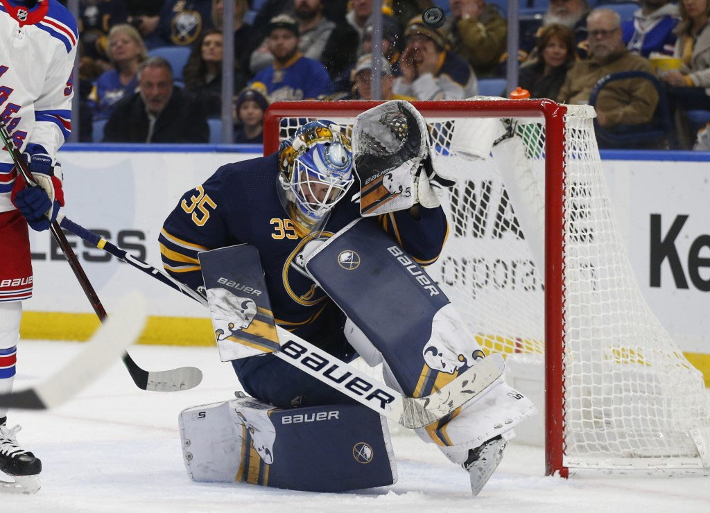 Buffalo Sabres goalie Linus Ullmark (35) makes a save during the second period of an NHL hockey game against the New York Rangers, Friday, Feb. 15, 20...