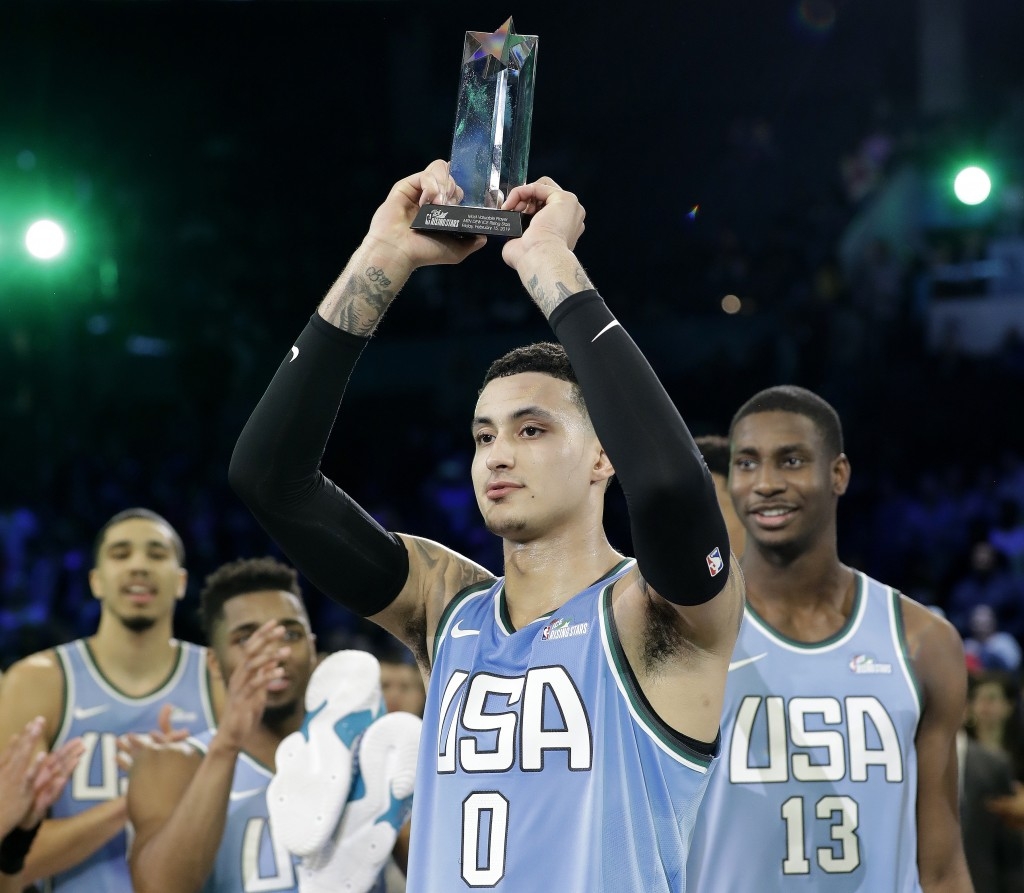 U.S. Team's Kyle Kuzma, of the Los Angeles Lakers holds the MVP trophy after the NBA All-Star Rising Stars basketball game between the World Team and ...