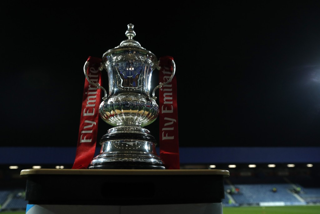 The English FA Cup trophy is placed on the pitch before the 5th round soccer match between Queens Park Rangers and Watford at Loftus Road stadium in L...