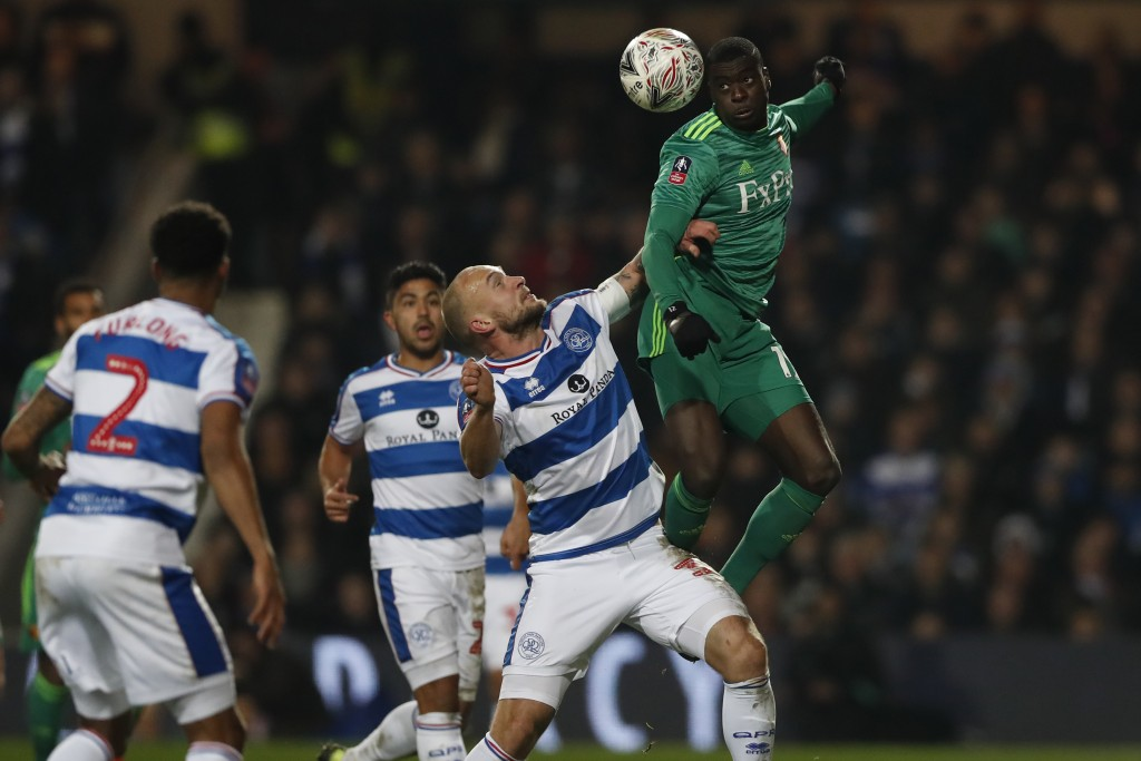 Watford's Ken Sema, right, heads the ball past Queens Park Rangers' Toni Leistner during the English FA Cup 5th round soccer match between Queens Park...