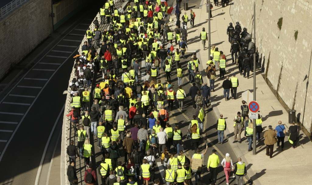 Yellow vest protesters march during a demonstration Saturday, Feb.16, 2019 in Marseille, southern France. Yellow vest protesters are holding scattered...