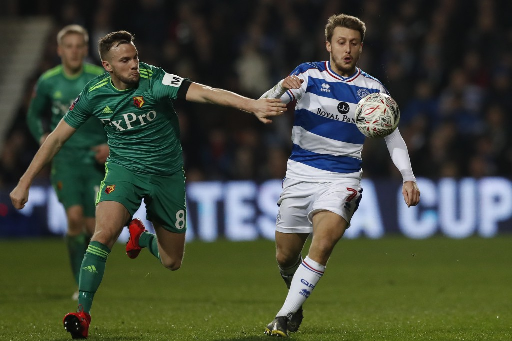 Queens Park Rangers' Luke Freeman, right, controls the ball past Watford's Tom Cleverley during the English FA Cup 5th round soccer match between Quee...
