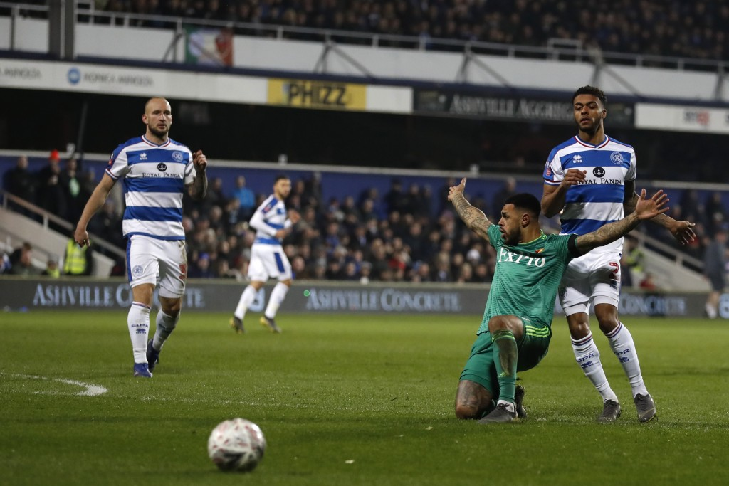 Watford's Andre Gray, second right claims a foul as he falls to the ground when viewing for the ball with Queens Park Rangers' Darnell Furlong during ...