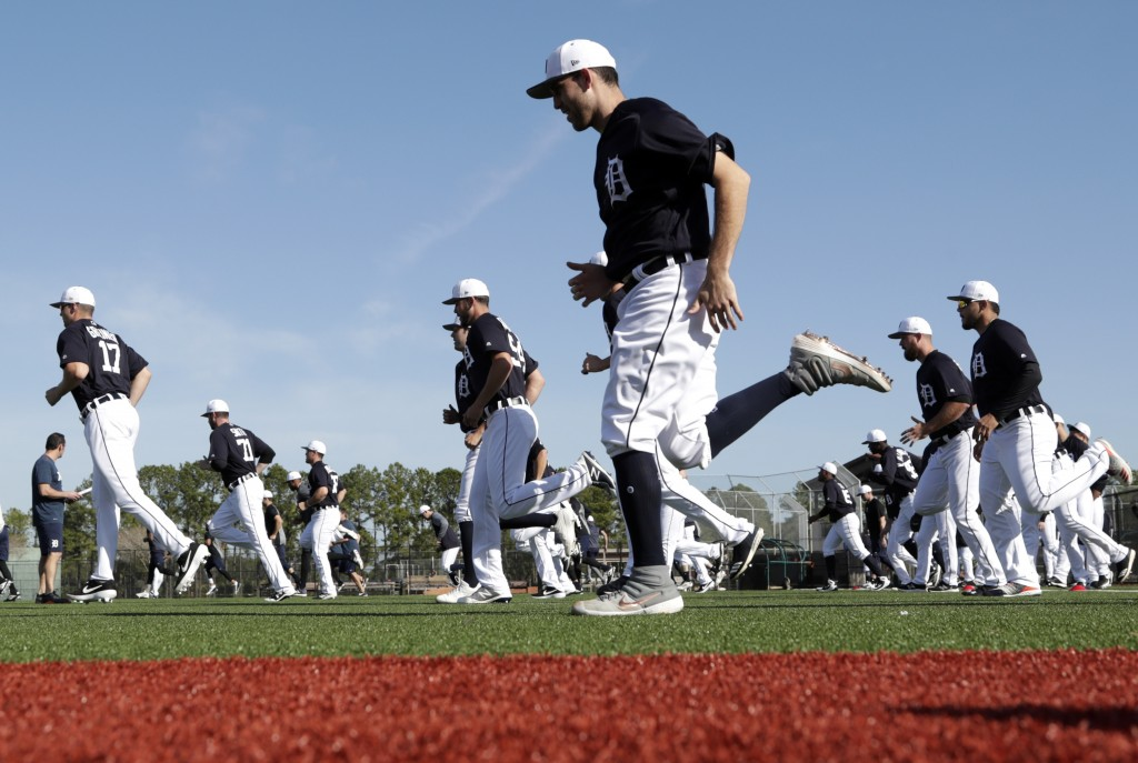 Detroit Tigers starting pitcher Matthew Boyd, center, loosens up at the Detroit Tigers spring training baseball facility, Friday, Feb. 15, 2019, in La...
