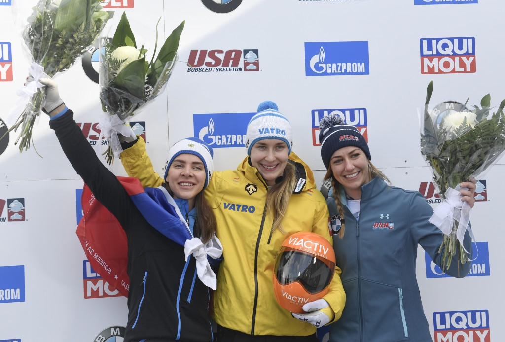 CORRECTS LOELLING, TO CENTER, AND TO GOLD MEDALIST - Gold medalist Jacqueline Loelling, center, of Germany, gold medalist Elena Nikitina, left, of Rus...