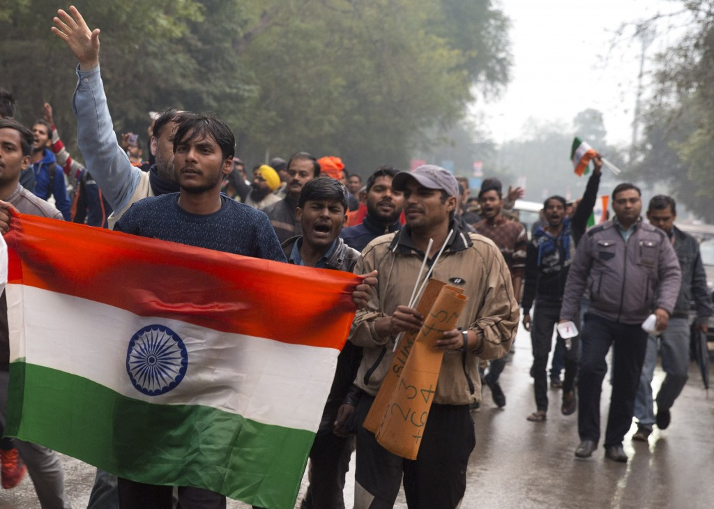 Indians protestor shouts slogans against Thursday's attack on a paramilitary to the Indian soldiers killed in Thursday's attack on a paramilitary conv...