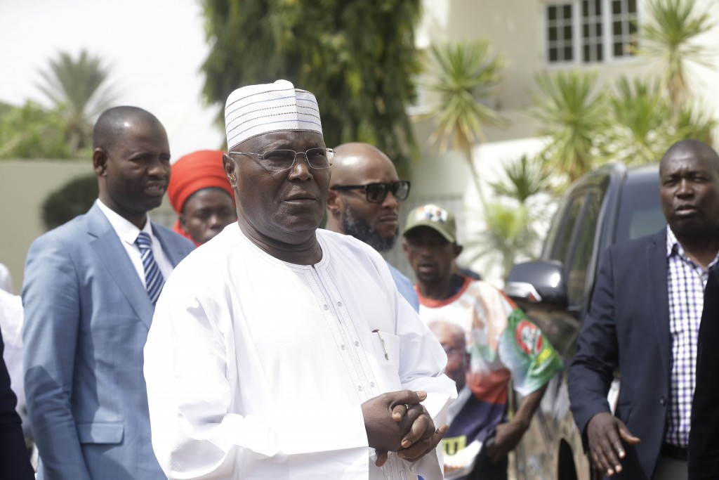 Nigerian presidential candidate, Atiku Abubakar, of the People's Democratic Party, speaks to journalists after the presidential election was delayed b...