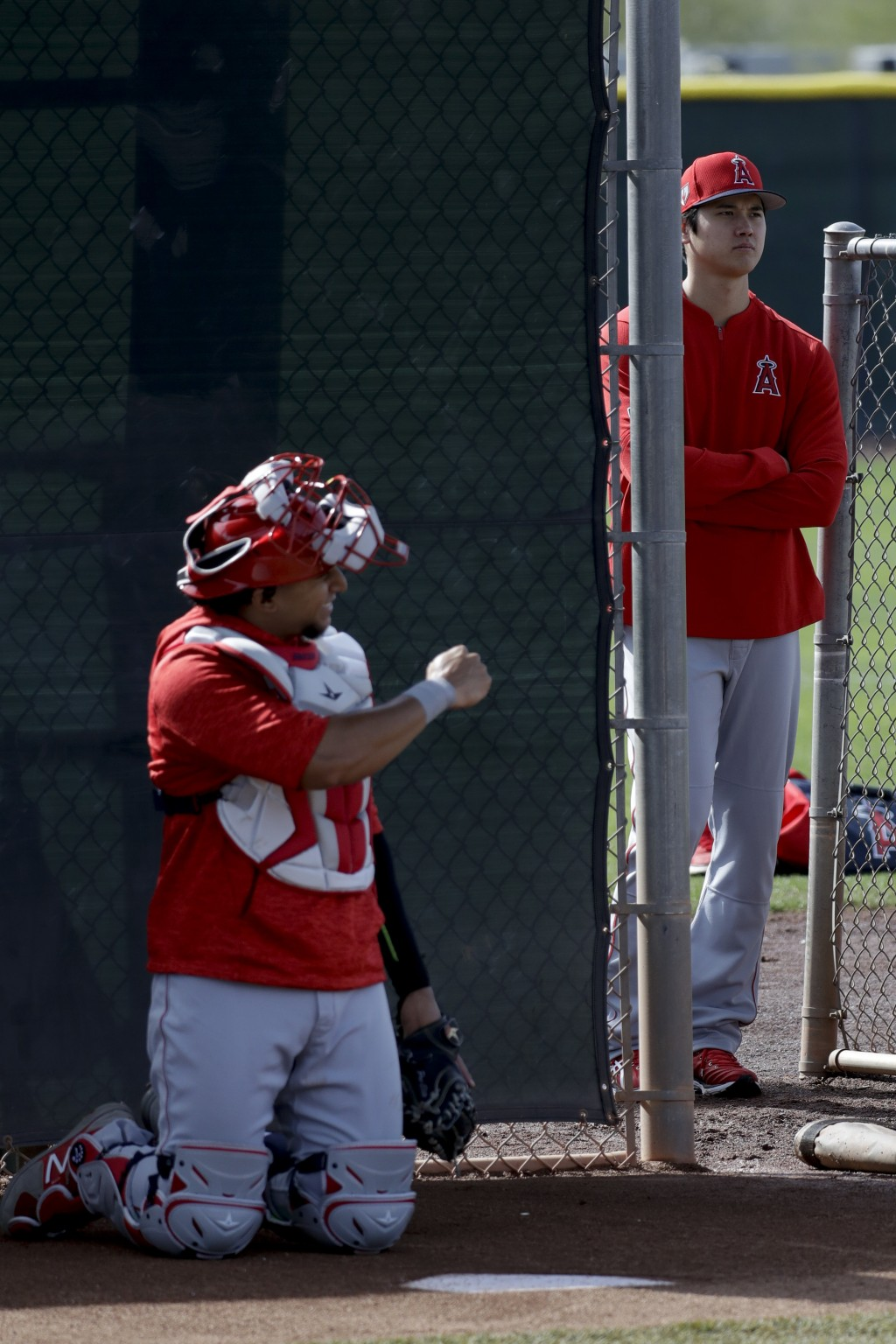 Los Angeles Angels' Shohei Ohtani, of Japan, right, watches pitchers during spring training baseball in Tempe, Ariz., Friday, Feb. 15, 2019. (AP Photo...