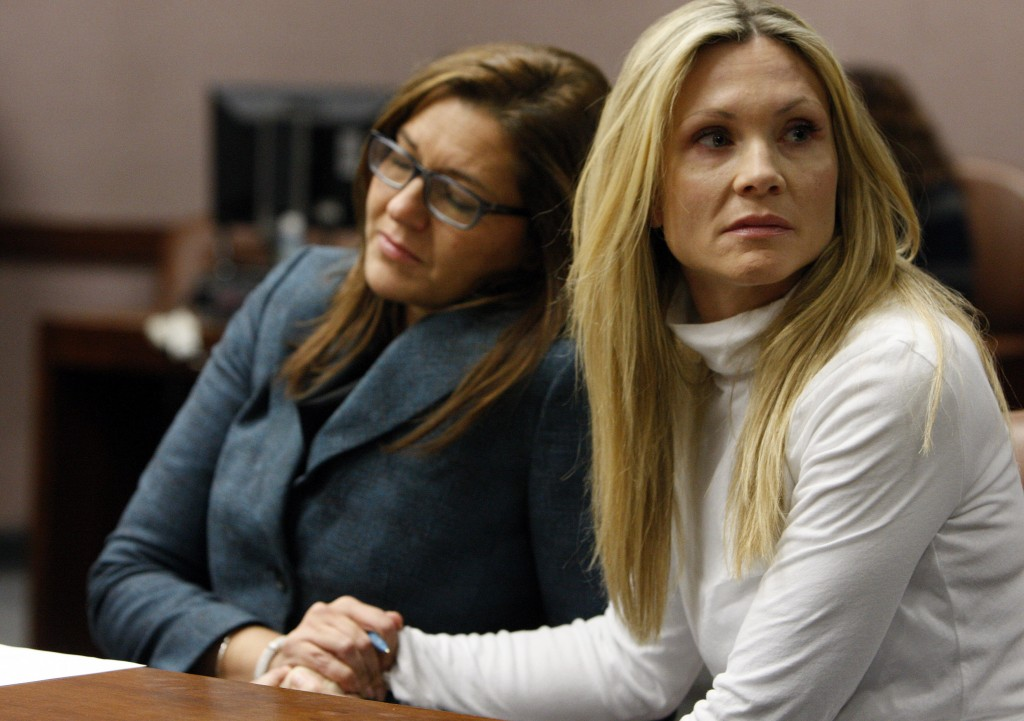 """FILE - This Nov. 27, 2012 file photo shows attorney Ellen Torregrossa-O'Connor, left, holding the hand of former """"Melrose Place"""" actress Amy Locane-Bo..."""