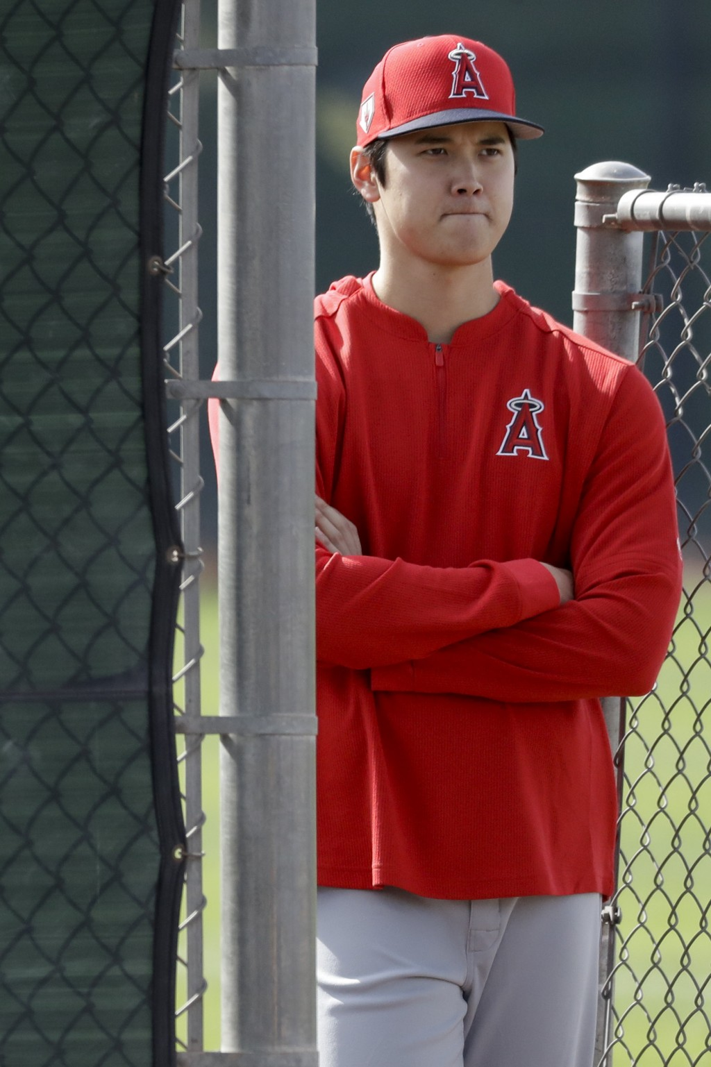 Los Angeles Angels Shohei Ohtani, of Japan, watches pitching practice at their spring baseball training facility in Tempe, Ariz., Friday, Feb. 15, 201...