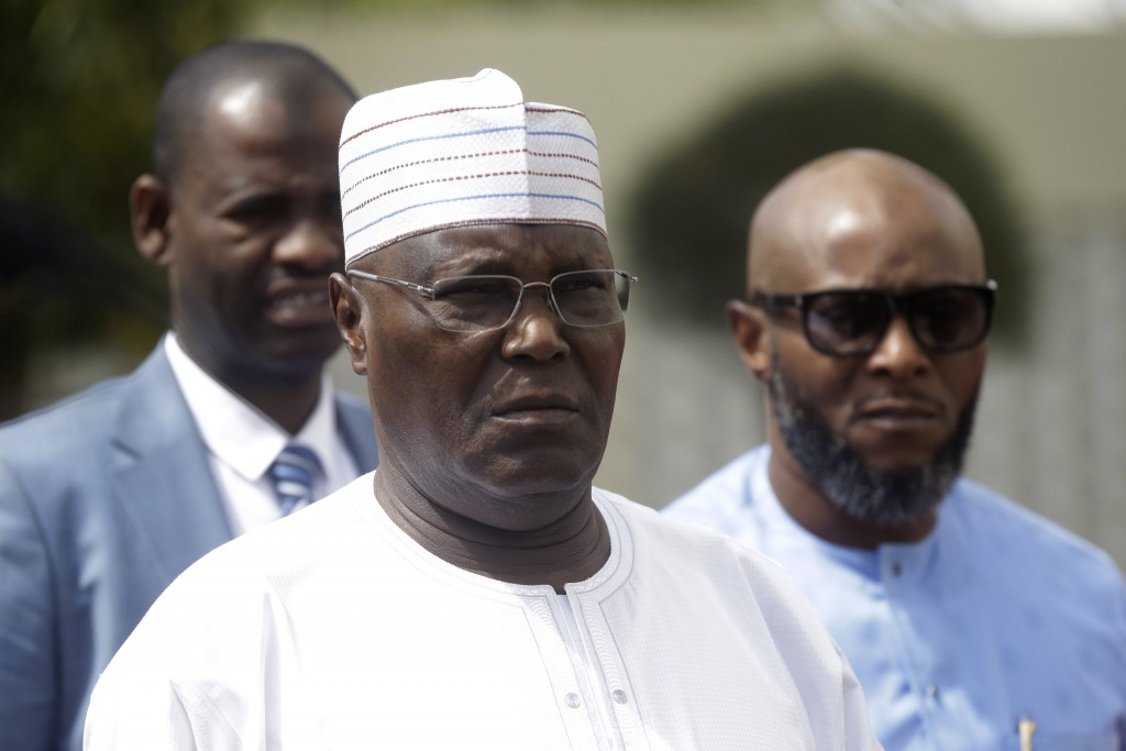 Nigerian presidential candidate, Atiku Abubakar, of the People's Democratic Party, arrives to speak with journalists after the presidential election w...