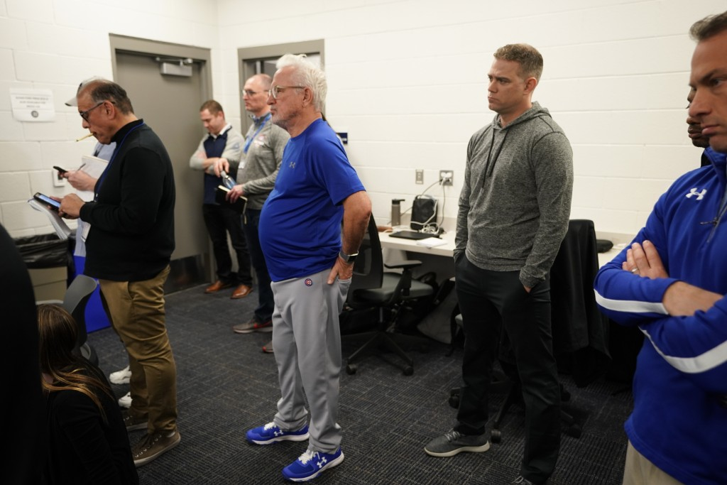 Chicago Cubs president of baseball operations Theo Epstein and manager Joe Maddon watch as Addison Russell answers questions at a press conference aft...