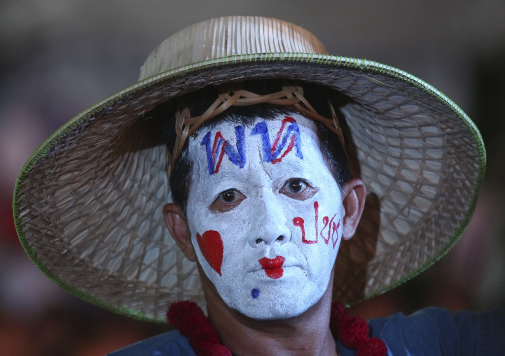 """In this Friday, Feb. 15, 2019, file photo, a supporter of Pheu Thai Party white paint with a message on his head reading """"Pheu Thai Party love people""""..."""