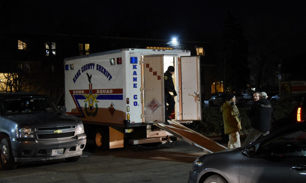 Investigators work at the apartment complex of the alleged shooter from the Henry Pratt Co. on Friday, Feb. 15, 2019, in Aurora, Ill. An employee of a...