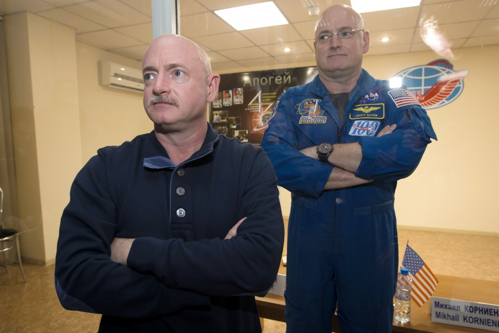 FILE - In this March 26, 2015 file photo, U.S. astronaut Scott Kelly, right, crew member of the mission to the International Space Station, stands beh...