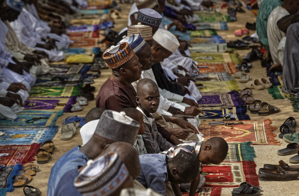 Muslims make traditional Friday prayers at a mosque near to the Emir's palace in Kano, northern Nigeria Friday, Feb. 15, 2019. Nigeria is due to hold ...