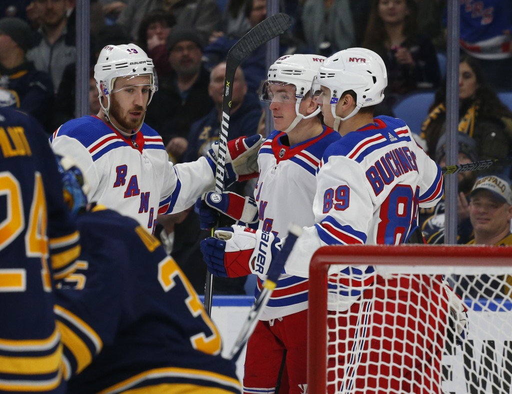 New York Rangers Kevin Hayes (18) Jimmy Vesey (26) and Pavel Buchnevich (90) celebrate a goal during the second period of an NHL hockey game against t...
