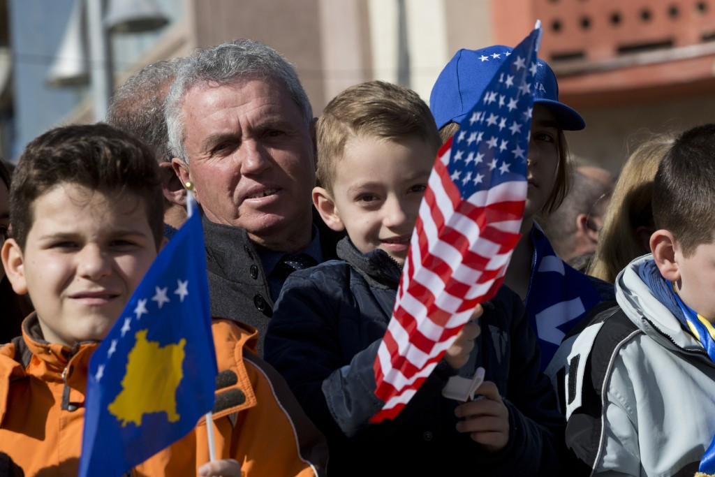 Kosovars waving national and U.S flags gather, during celebrations to mark the 11th anniversary of independence, in Pristina, Sunday, Feb. 17, 2019. K...