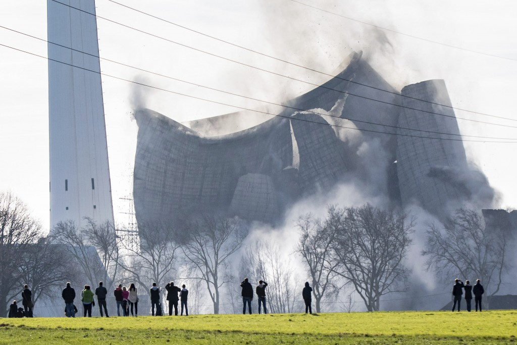 The cooling tower of the former Knepper power station collapses during the blasting of the former coal-fired power station in Dortmund, Germany, Sunda...