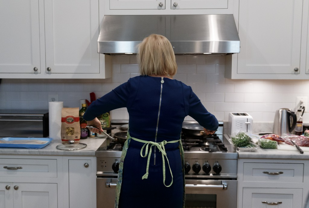 Sen. Kirsten Gillibrand, D-N.Y., cooks dinner at her home in Washington, Tuesday, Feb. 12, 2019. Gillibrand isn't just embracing her role as a mother ...