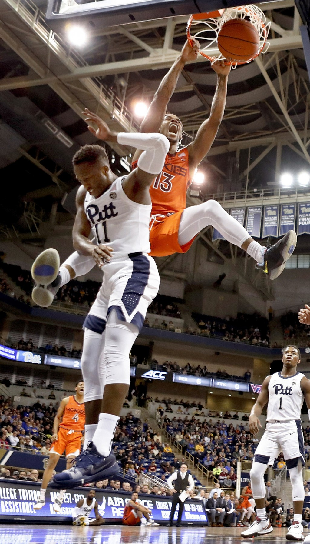 Virginia Tech's Ahmed Hill, right, dunks behind Pittsburgh's Sidy N'Dir (11) during the first half of an NCAA college basketball game, Saturday, Feb. ...