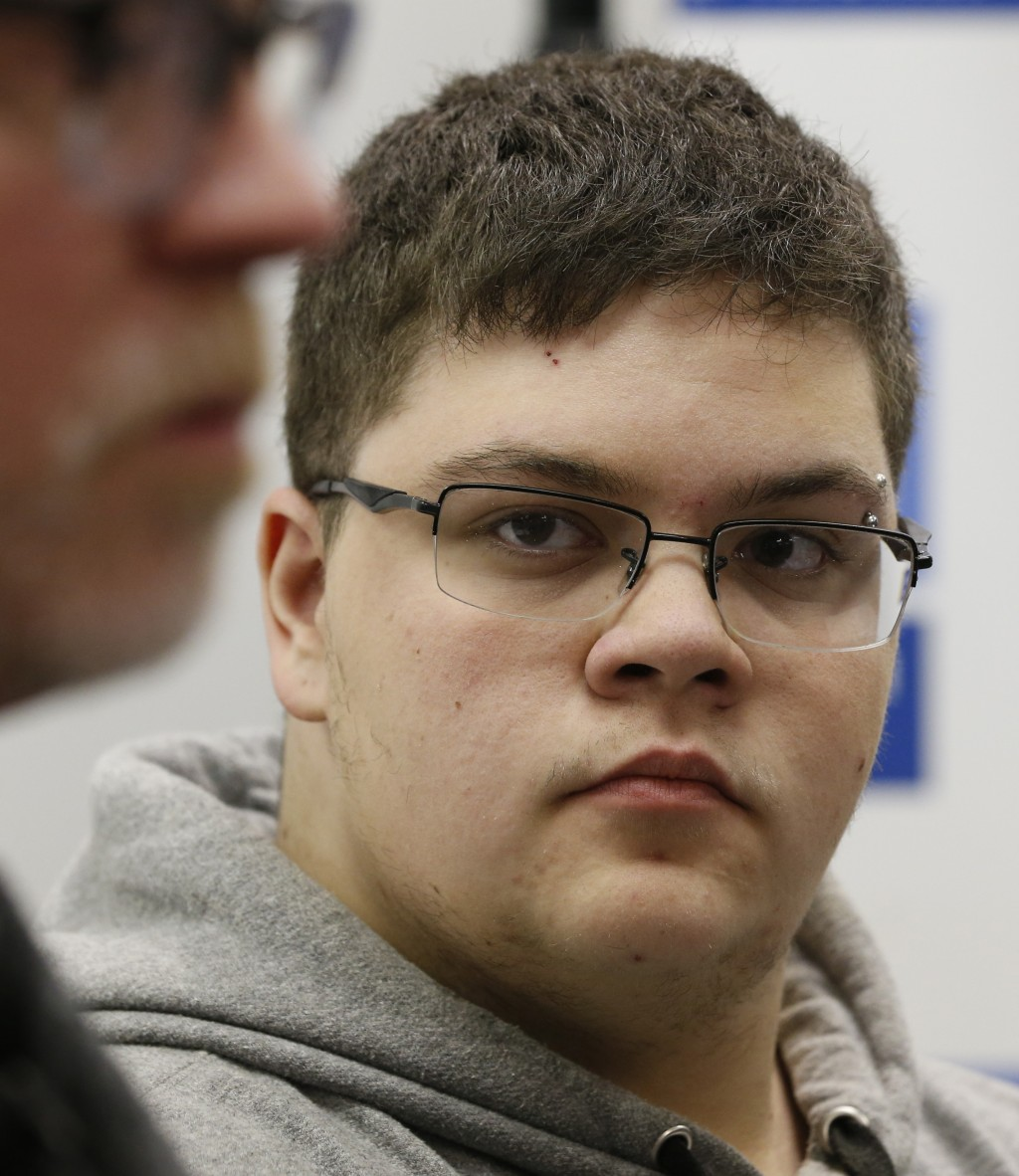 FILE - In this March 6, 2017, file photo, Gloucester County High School senior Gavin Grimm, a transgender student, listens to a speaker during a news