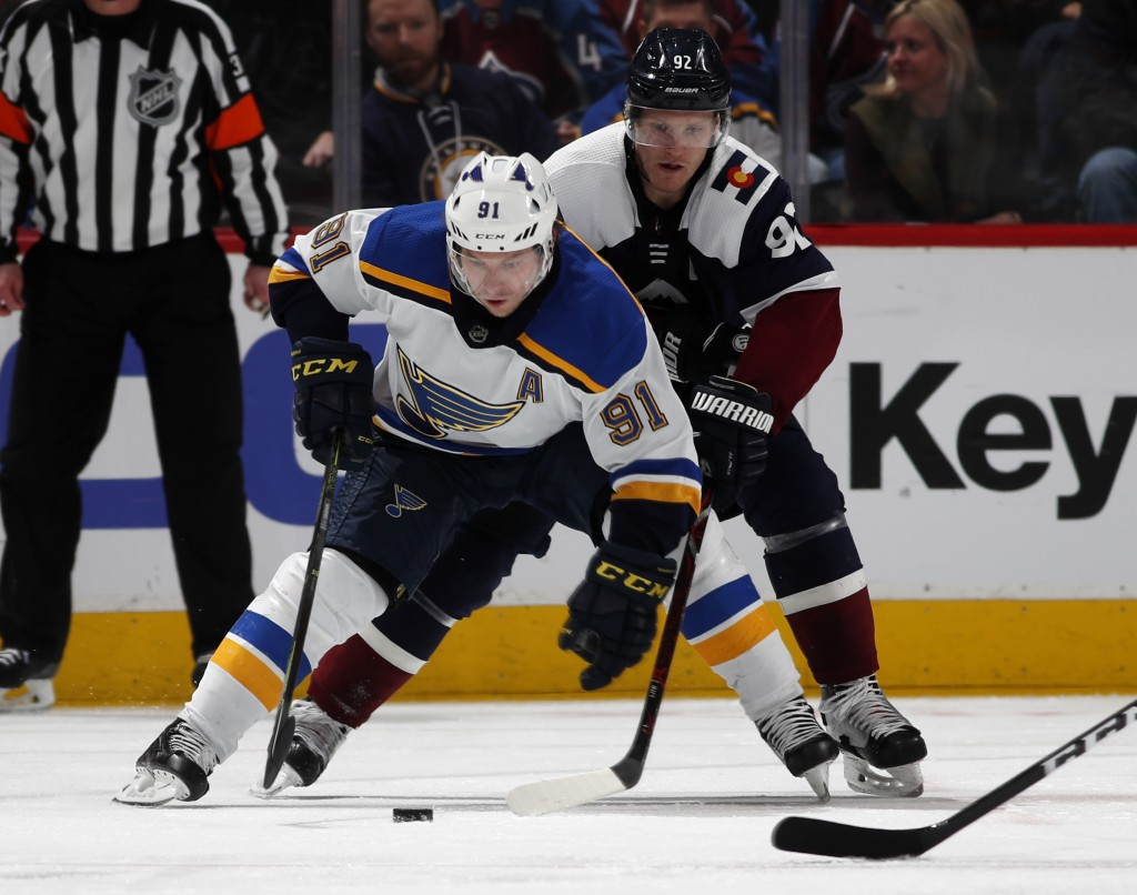 St. Louis Blues right wing Vladimir Tarasenko, front, collects the puck as Colorado Avalanche left wing Gabriel Landeskog defends in the third period ...