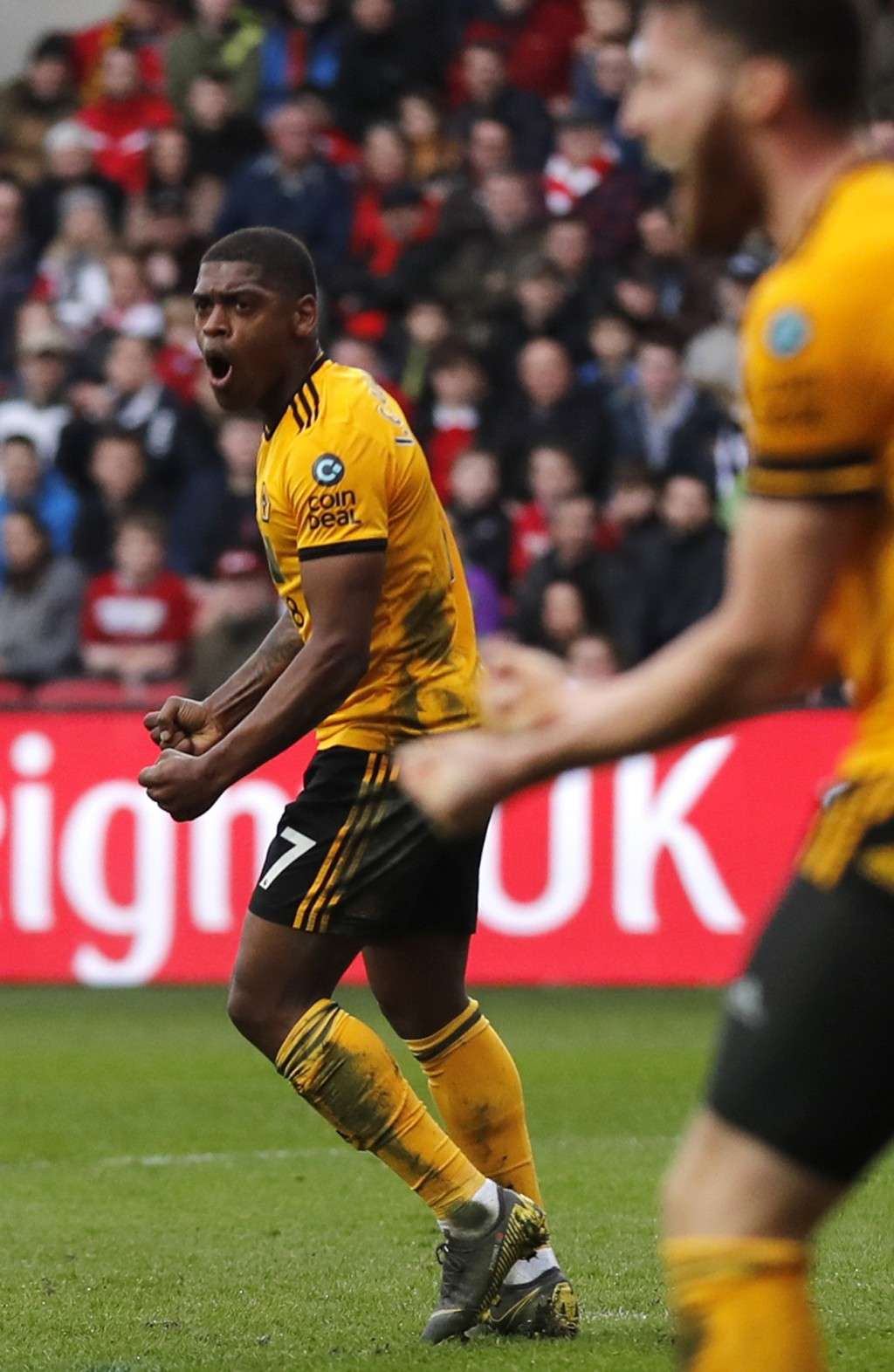 Wolverhampton's Ivan Cavaleiro, left, celebrates after scoring the opening goal during the English FA Cup fifth round soccer match between Bristol Cit...