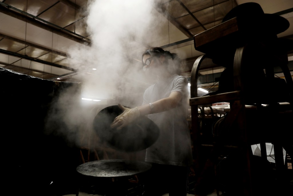 Steam is used to mould a fur hat in Borsalino's hat factory, in Spinetta Marengo, near Alessandria, Italy, Thursday, Jan. 17, 2019. Borsalino's prized...