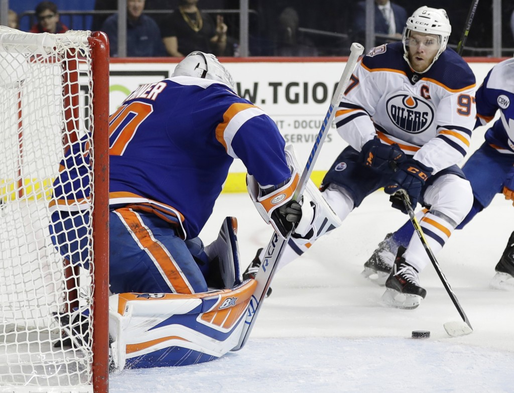 Edmonton Oilers' Connor McDavid (97) attempts to score on New York Islanders goaltender Robin Lehner during the first period of an NHL hockey game Sat...