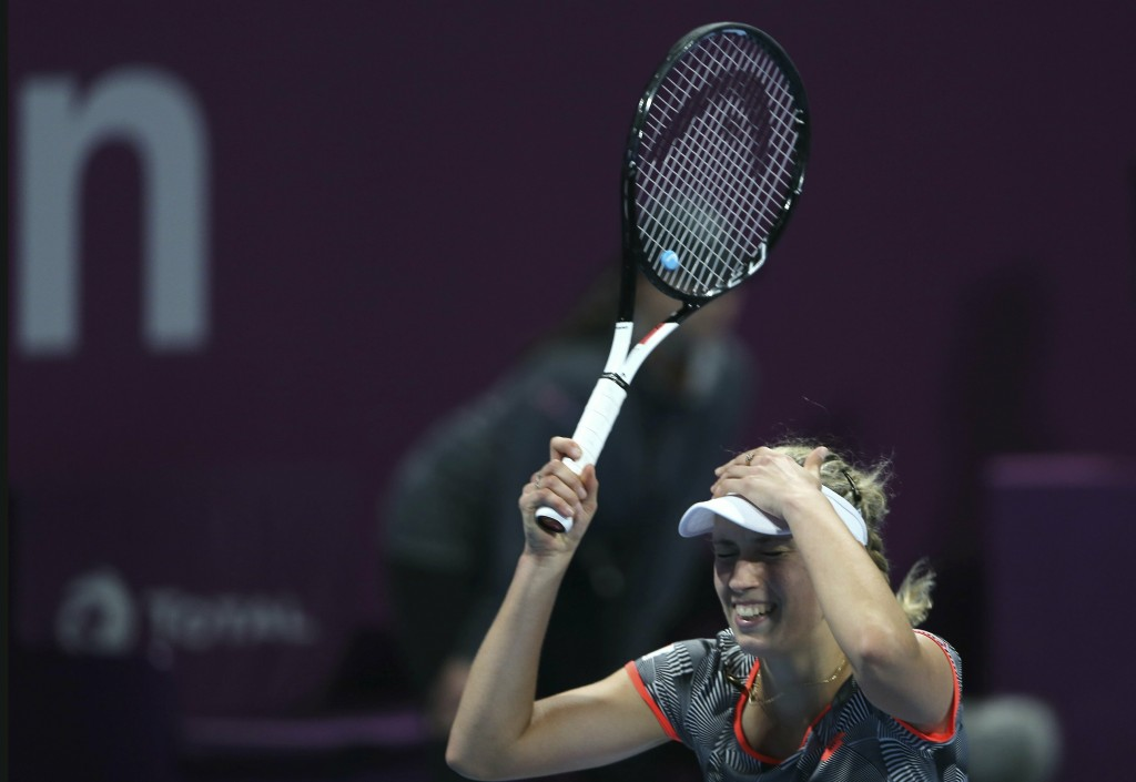 Belgium's Elise Mertens reacts after defeating Romania's Simona Halep in a final match of the the Qatar Open tennis tournament in Doha, Qatar, Saturda...