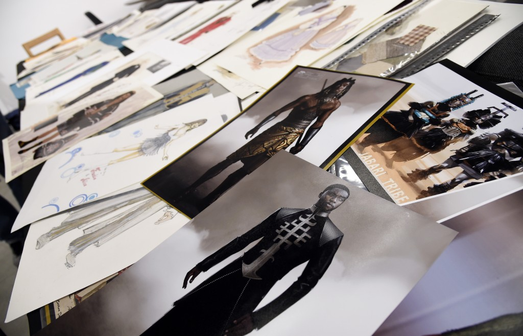 """This Jan. 15, 2019 photo shows renderings of fashions created by Oscar nominated costume designer Ruth E. Carter for the film """"Black Panther,"""" foregro..."""