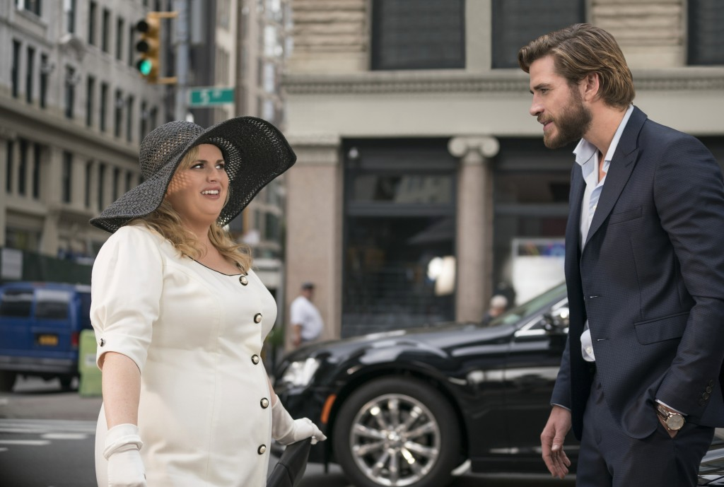 """This image released by Warner Bros. Pictures shows Rebel Wilson, left, and Liam Hemsworth in a scene from the film, """"Isn't It Romantic."""" (Michael Parm..."""