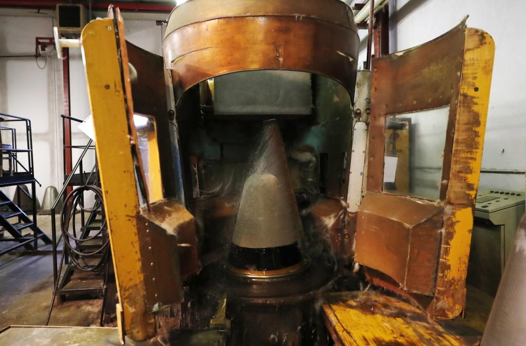 A machine uses water to shape a fur hat in Borsalino's fur factory, in Spinetta Marengo, near Alessandria, Italy, Thursday, Jan. 17, 2019. Borsalino's...
