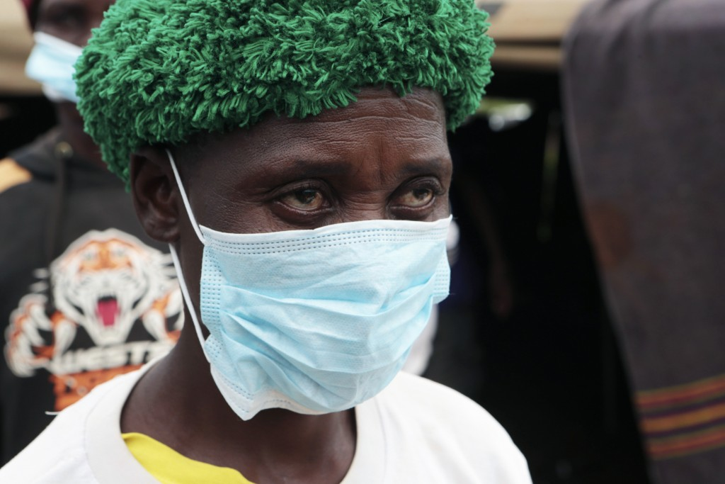 A woman emerges from a tent where bodies of the small-scale gold miners who were caught underground Tuesday are being identified,  on the outskirts of...