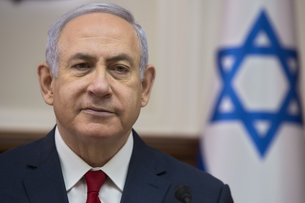 Israeli Prime Minister Benjamin Netanyahu chairs the weekly cabinet meeting at the Prime Minister's office in Jerusalem, Sunday, Feb. 17, 2019. (AP Ph...
