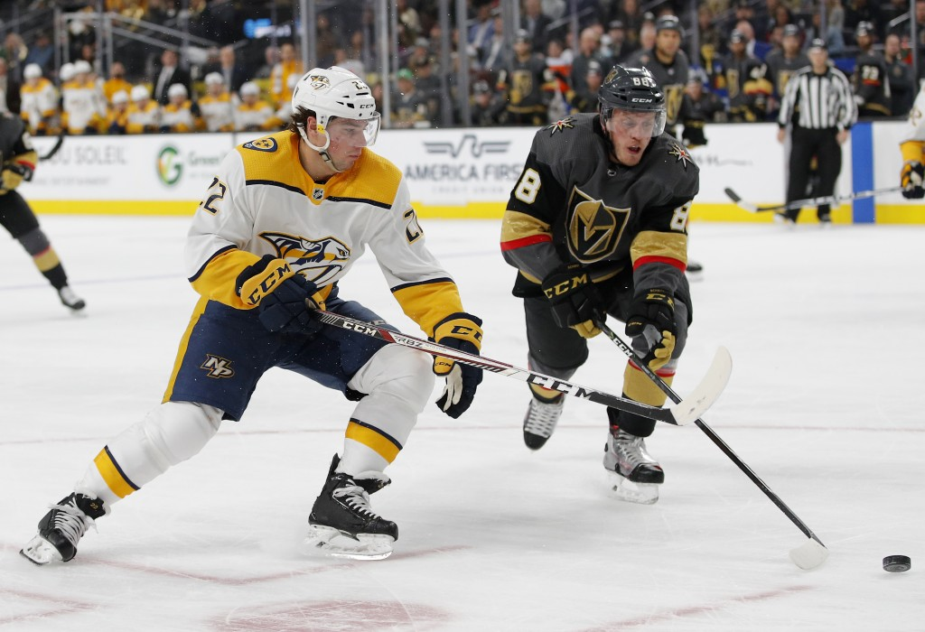Nashville Predators left wing Kevin Fiala, left, and Vegas Golden Knights defenseman Nate Schmidt (88) vie for the puck during the first period of an ...