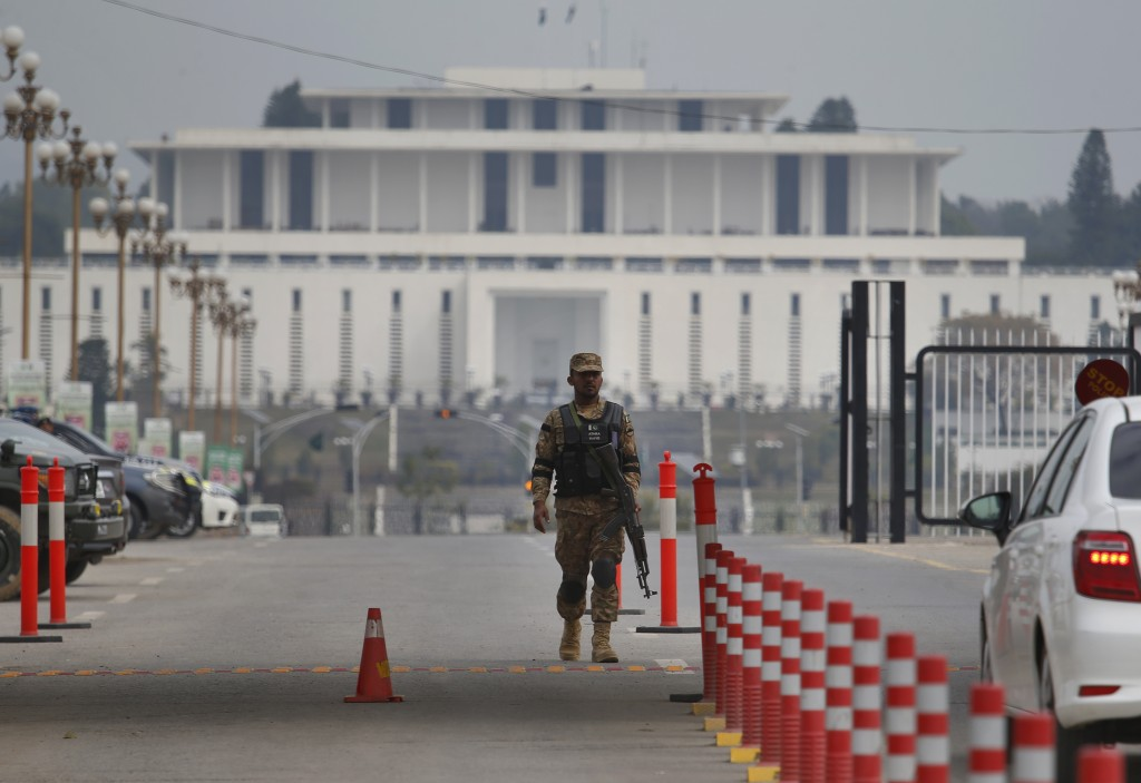 A Pakistani army soldier patrols at a checkpoint near presidency to ensure security ahead of Saudi Arabia's crown prince visit to Pakistan, in Islamab...