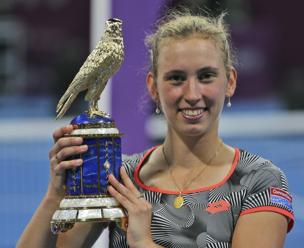 Belgium's Elise Mertens poses with her trophy after she defeated Romania's Simona Halep in a final match of the Qatar Open tennis tournament in Doha, ...